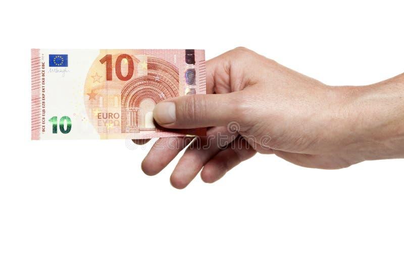 Mão que guarda a conta de dez euro foto de stock royalty free