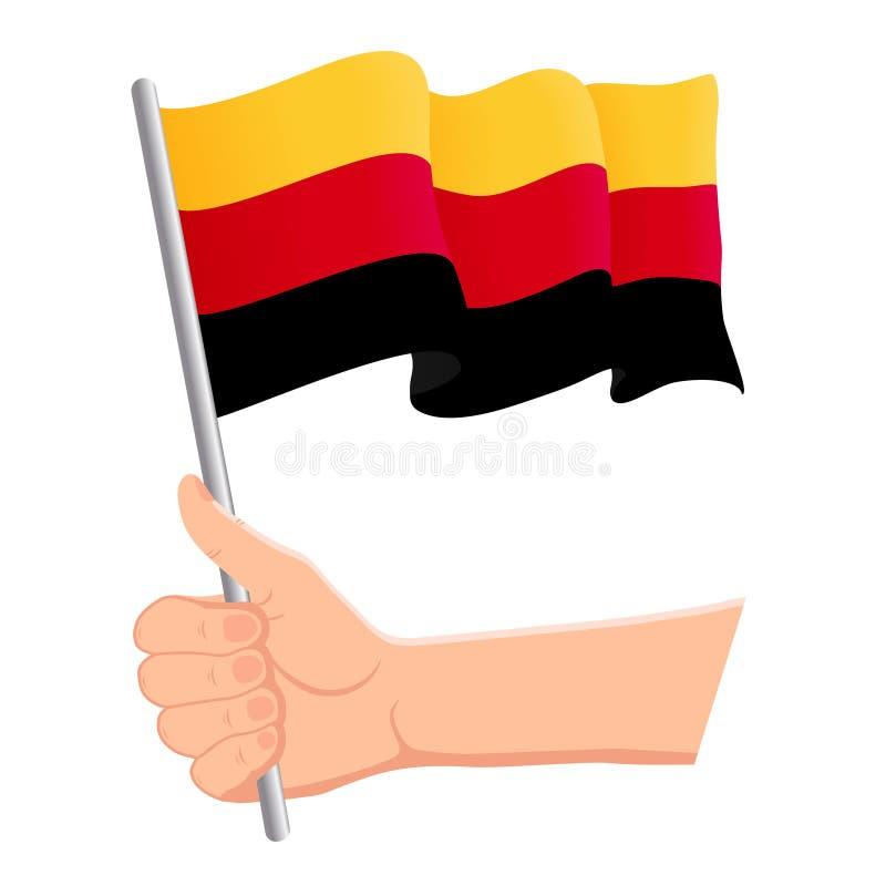 Mão que guarda e que acena a bandeira nacional de Alemanha r Ilustra??o do vetor ilustração stock