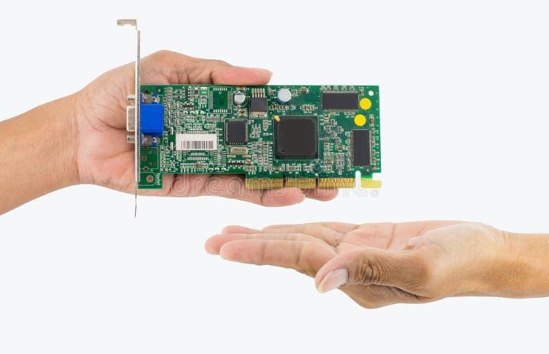 Mão que guarda a microplaqueta de IC foto de stock royalty free