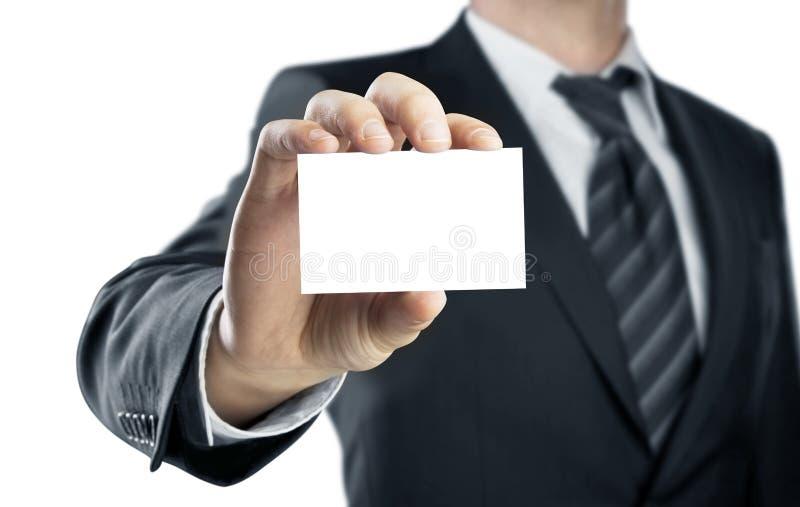 Mão que guarda o cartão foto de stock
