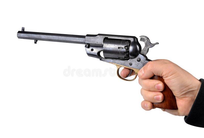 Mão que guarda o revólver da percussão imagens de stock royalty free