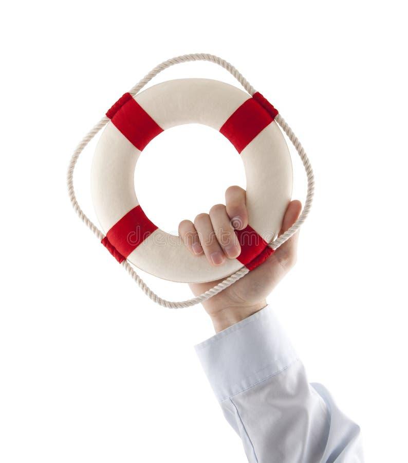 Mão que guarda um boia salva-vidas imagem de stock royalty free
