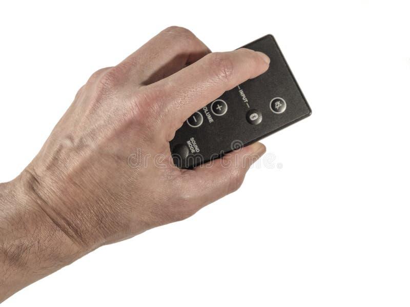 Mão que guarda um de controle remoto foto de stock royalty free