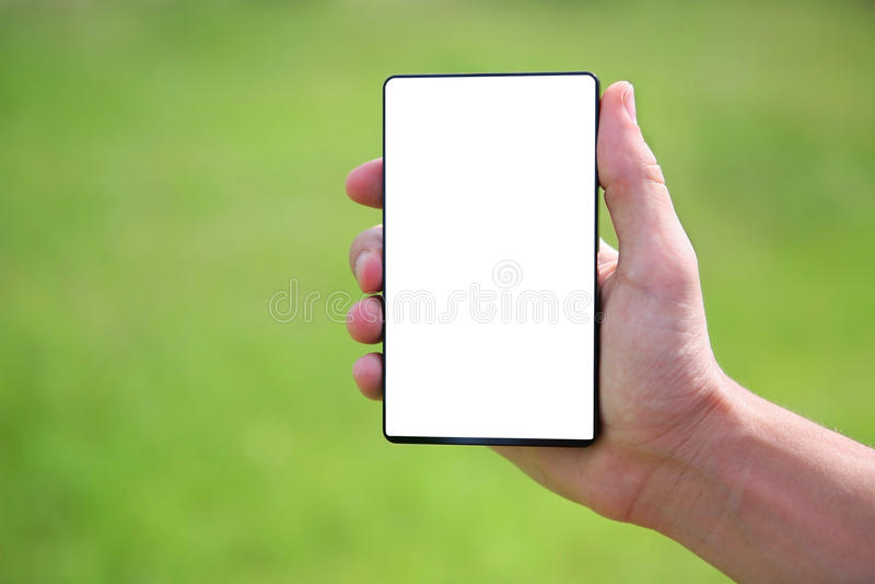 Mão que guarda um telefone esperto foto de stock royalty free
