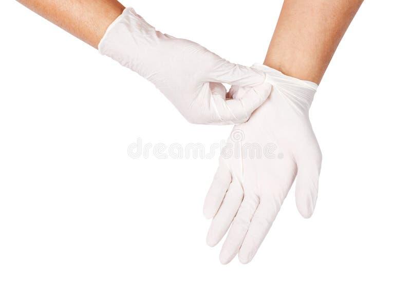 Mão que joga afastado as luvas descartáveis brancas médicas fotos de stock