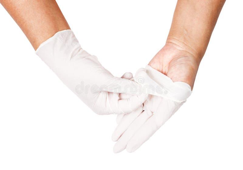 Mão que joga afastado as luvas descartáveis brancas médicas imagens de stock royalty free