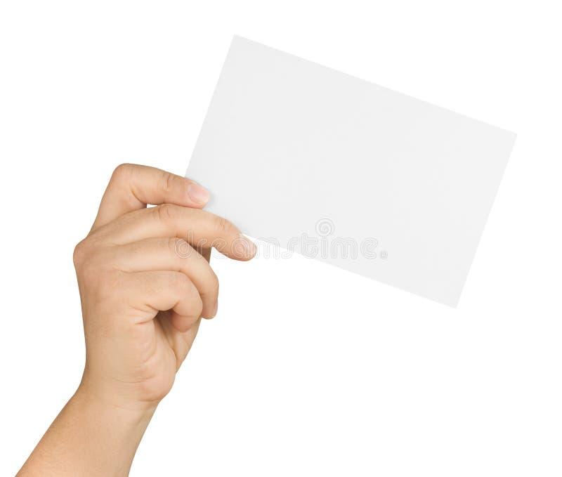 Mão que mantém o cartão branco vazio isolado fotografia de stock royalty free