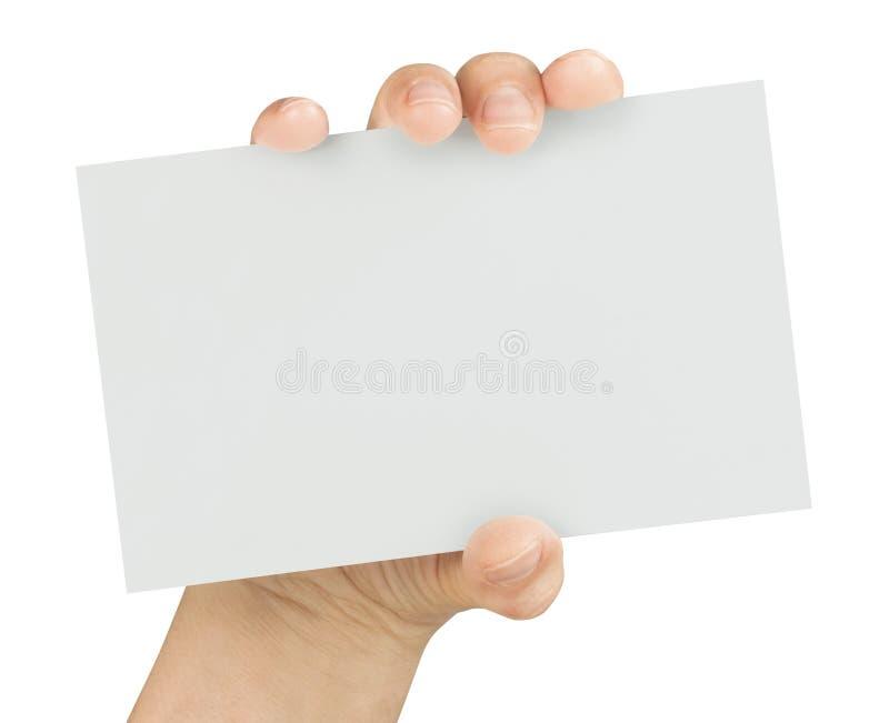 Mão que mantém o cartão vazio isolado fotografia de stock royalty free