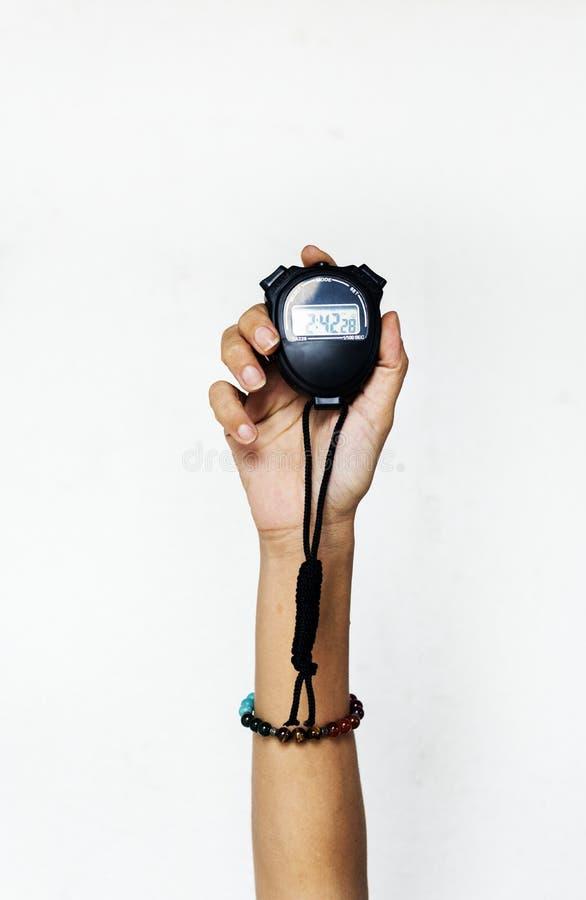 Mão que mantém o cronômetro isolado no fundo branco imagem de stock royalty free