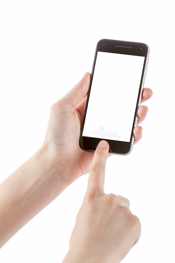 Mão que mantém o móbil do smartphone isolado no branco fotografia de stock
