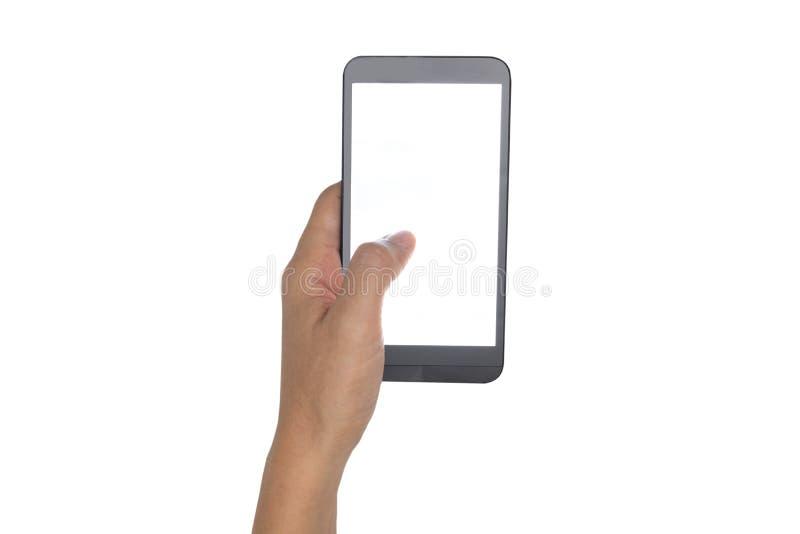 Mão que mantém o smartphone isolado no branco imagem de stock