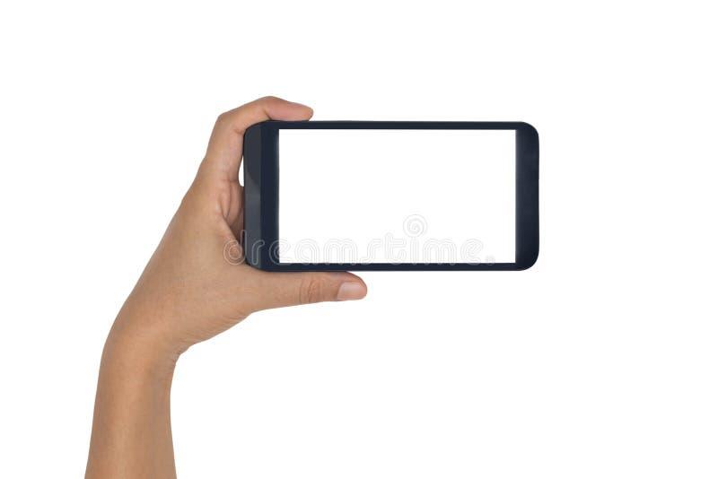 Mão que mantém o smartphone isolado no branco fotos de stock