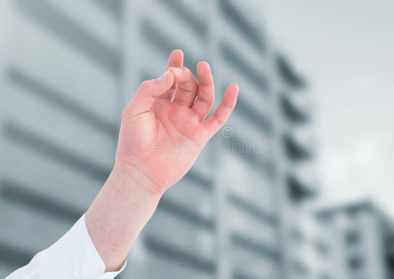 Mão que medita pelo prédio de escritórios fotos de stock royalty free