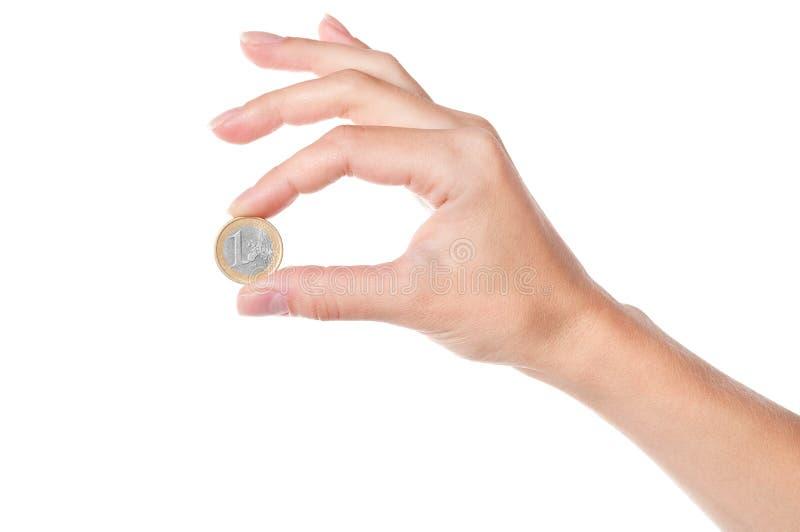 Mão que prende 1 euro- moeda fotos de stock