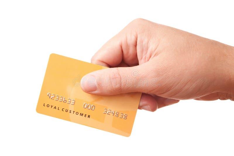 Mão que prende cartão plástico não identificado foto de stock