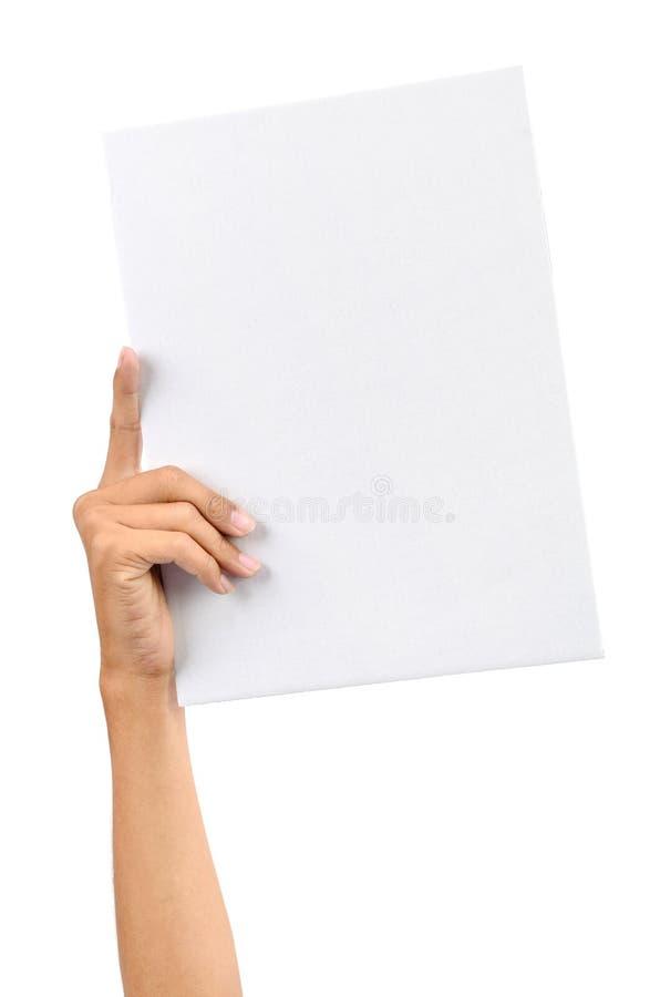 Mão que prende o cartão branco fotos de stock royalty free