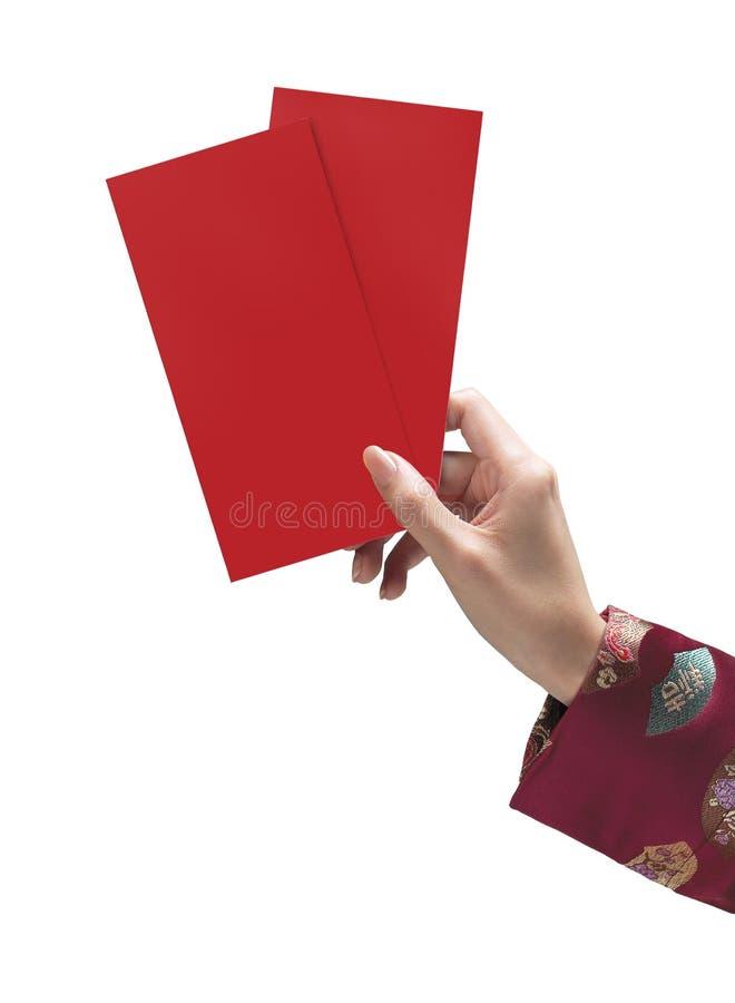 Mão que prende o cartão vermelho fotos de stock