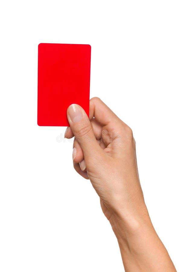 Mão que prende o cartão vermelho imagem de stock