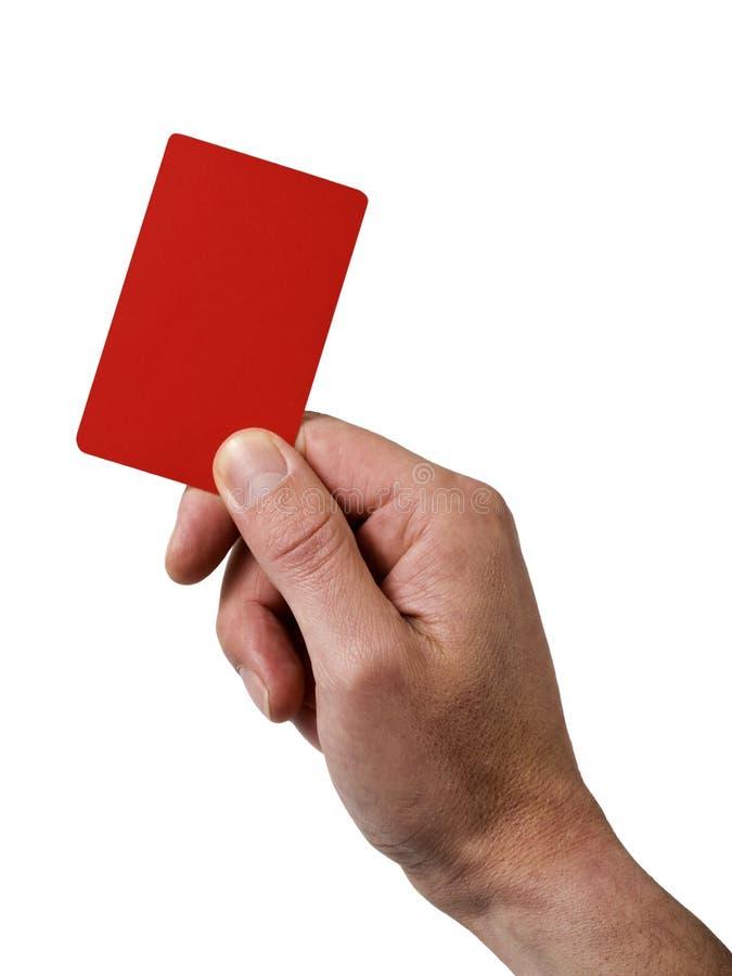 Mão que prende o cartão vermelho da penalidade fotos de stock royalty free