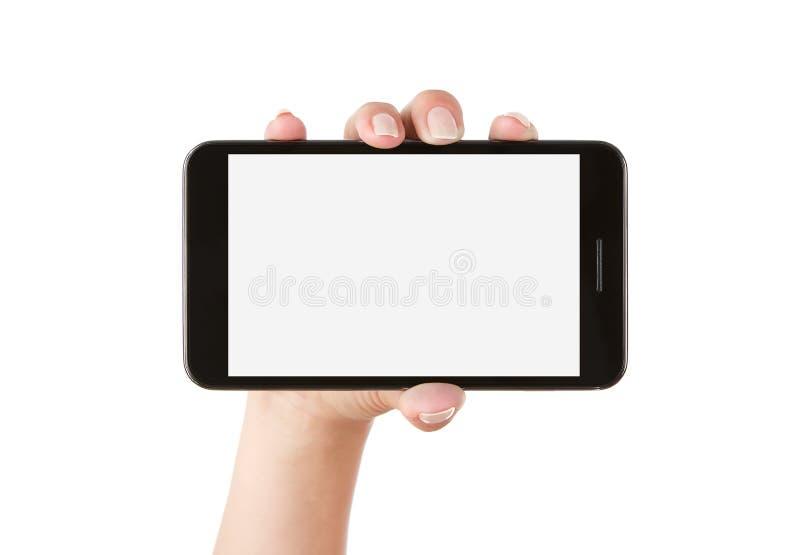Mão que prende o telefone esperto em branco foto de stock royalty free