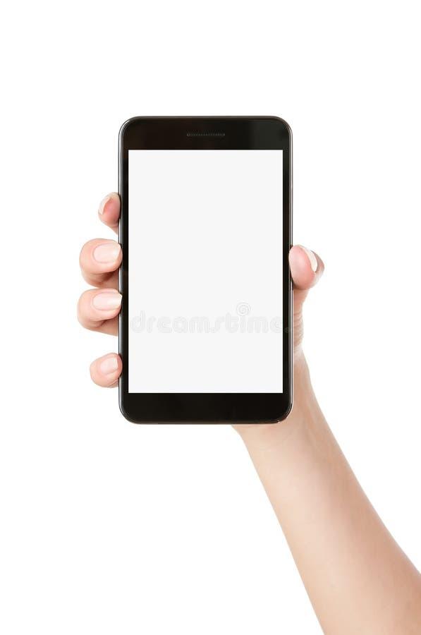 Mão que prende o telefone esperto em branco fotografia de stock