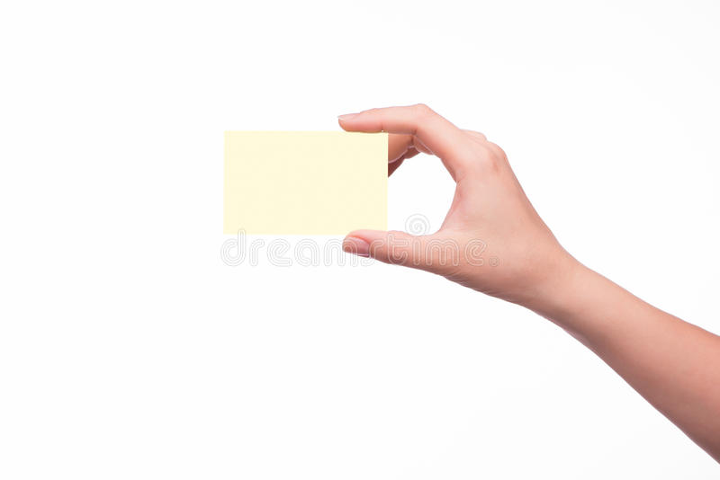 Mão que prende um cartão foto de stock royalty free