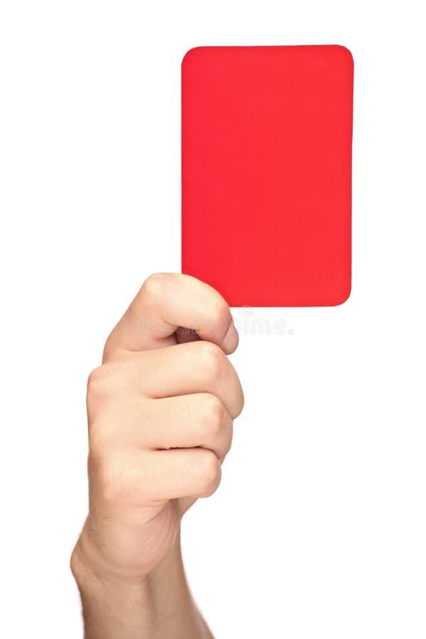 Mão que prende um cartão vermelho imagens de stock royalty free