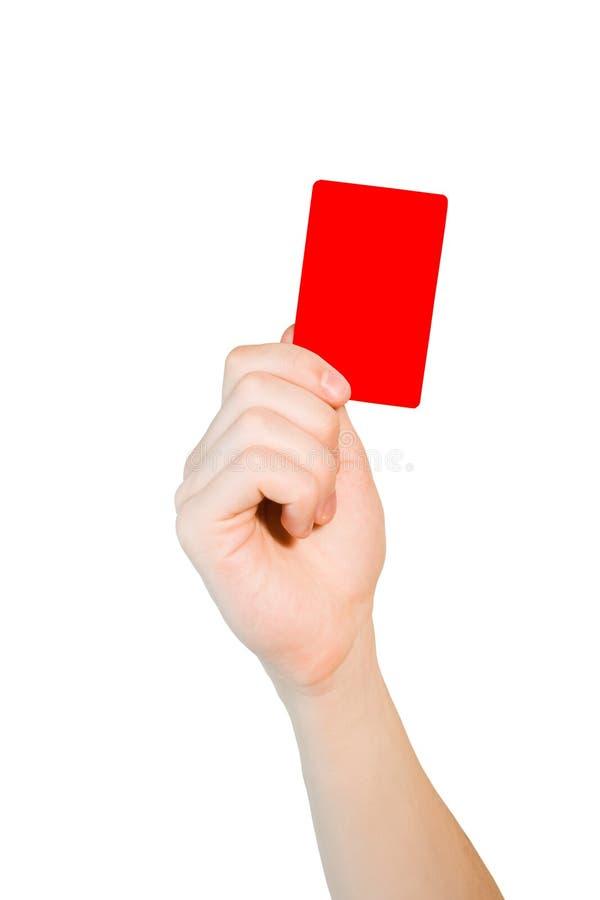 Mão que prende um cartão vermelho imagens de stock