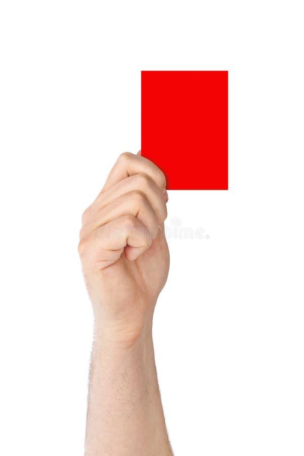Mão que prende um cartão vermelho imagem de stock