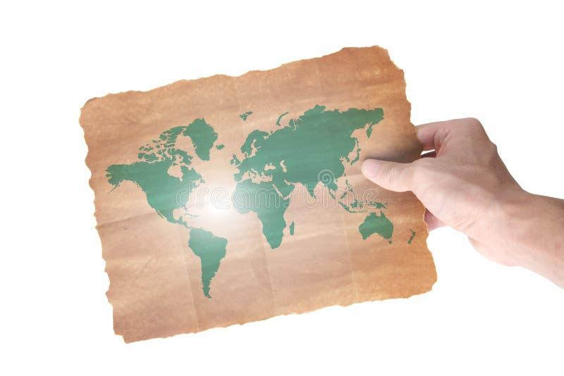 Mão que prende um mapa do papel do mundo foto de stock royalty free