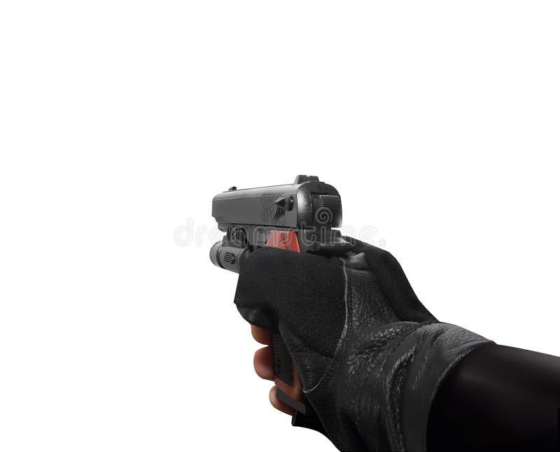 Mão que prende um revólver imagens de stock royalty free