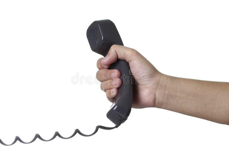 Mão que prende um telefone imagem de stock royalty free