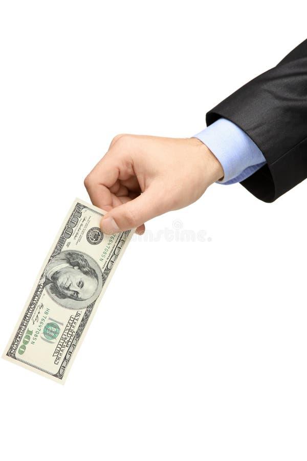 Mão que prende uma nota de banco do dólar americano 100 foto de stock royalty free