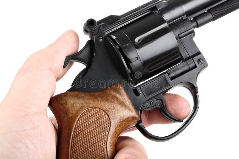 Mão que puxa o disparador isolado no branco fotografia de stock royalty free