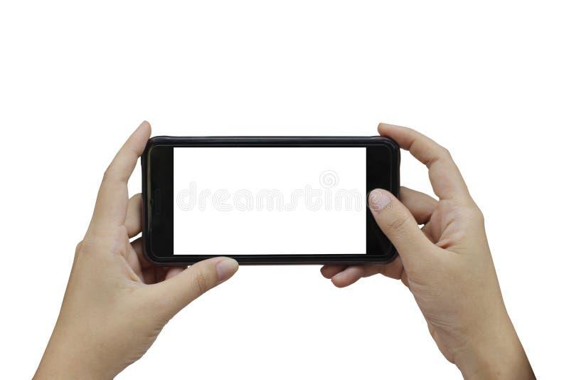 Mão usando o smartphone com a tela vazia branca no backgroun branco imagens de stock royalty free