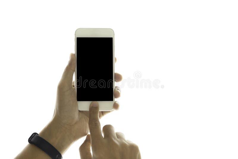 M?o usando o telefone celular isolado no trajeto de grampeamento fotos de stock