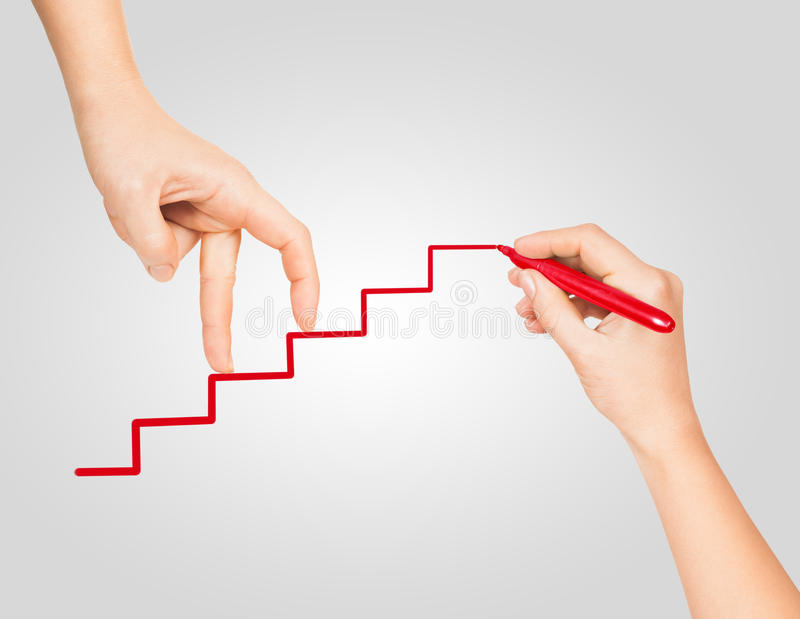 A mão vai acima do marcador vermelho pintado escada da carreira fotos de stock