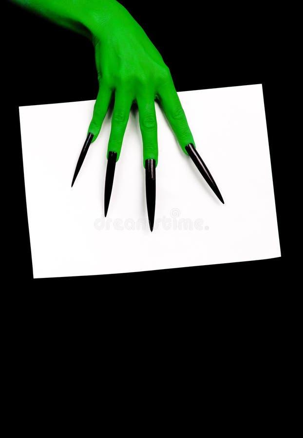 Mão verde com espaço para o texto. imagens de stock