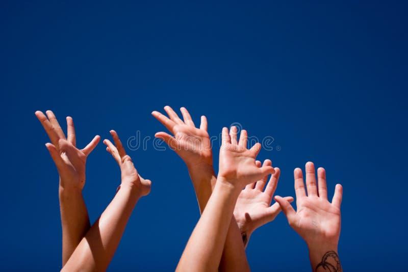 Mãos acima no ar foto de stock royalty free