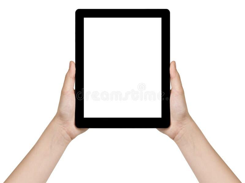 Mãos adolescentes fêmeas que mantêm a tabuleta genérica vertical imagem de stock