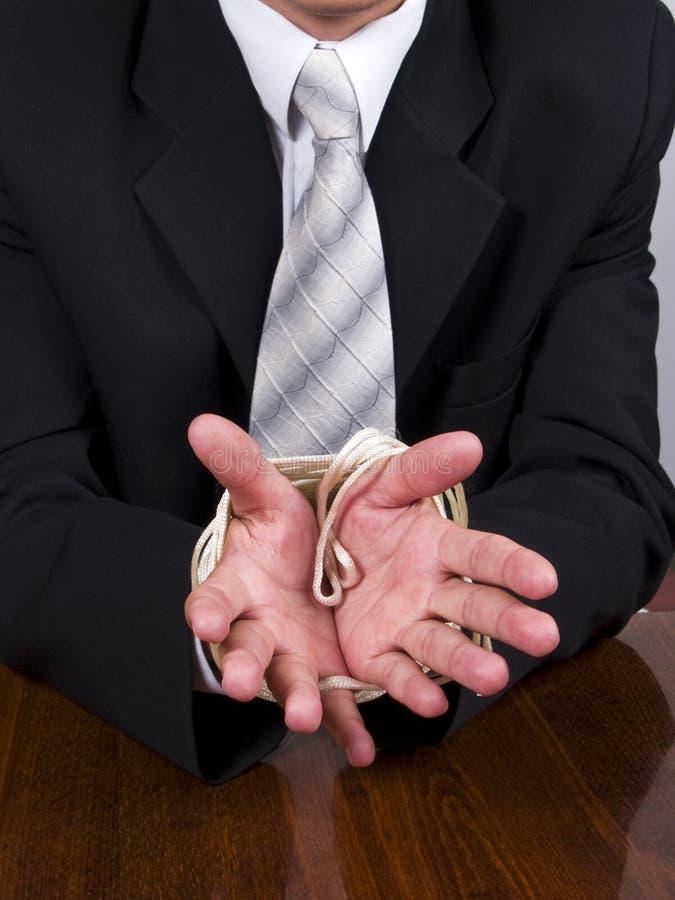 Mãos amarradas do homem de negócio fotos de stock royalty free