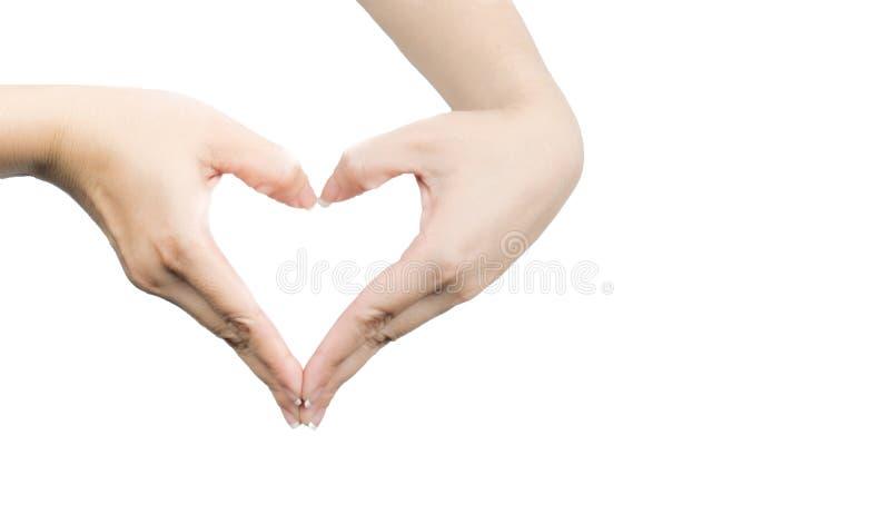 Mãos asiáticas bonitas e saudáveis da mulher com tratamento de mãos puro em uma forma do coração foto de stock royalty free