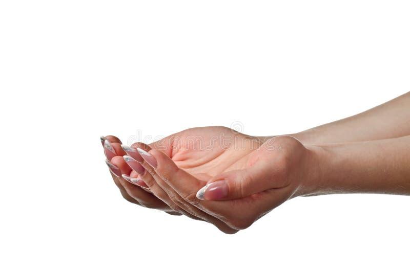 Mãos colocadas fêmea. Tiro do estúdio imagem de stock
