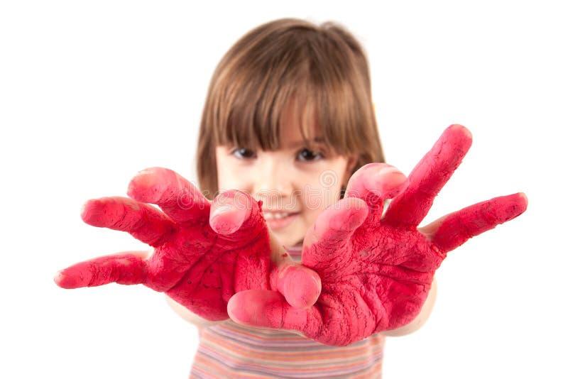 Menina com mãos coloridas no fundo branco imagem de stock royalty free