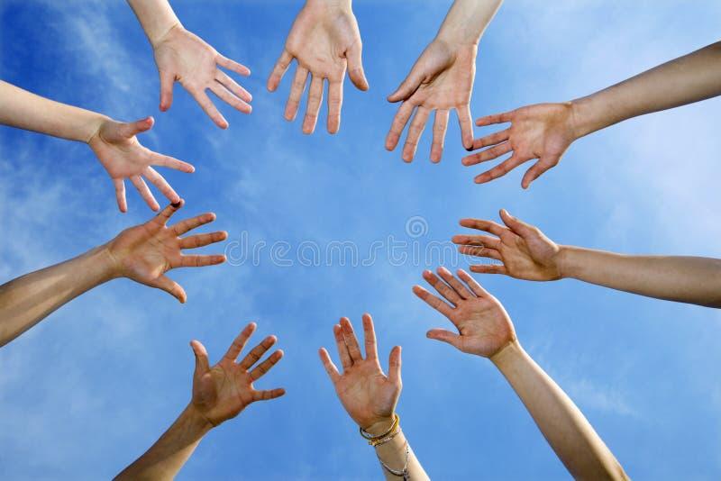Mãos da equipe