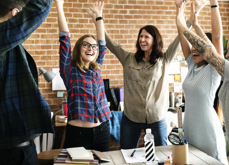 Mãos da equipe do negócio levantadas com bem sucedido fotos de stock