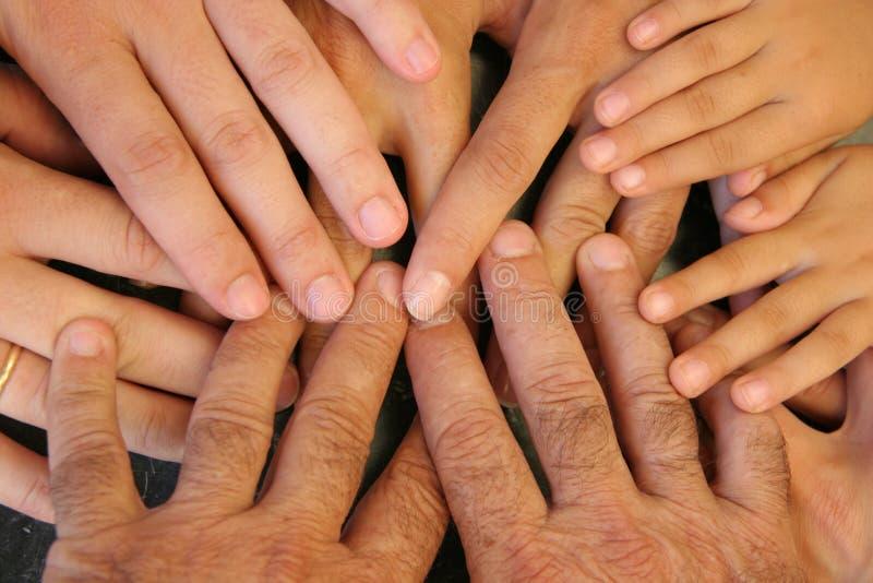 Mãos da família imagem de stock