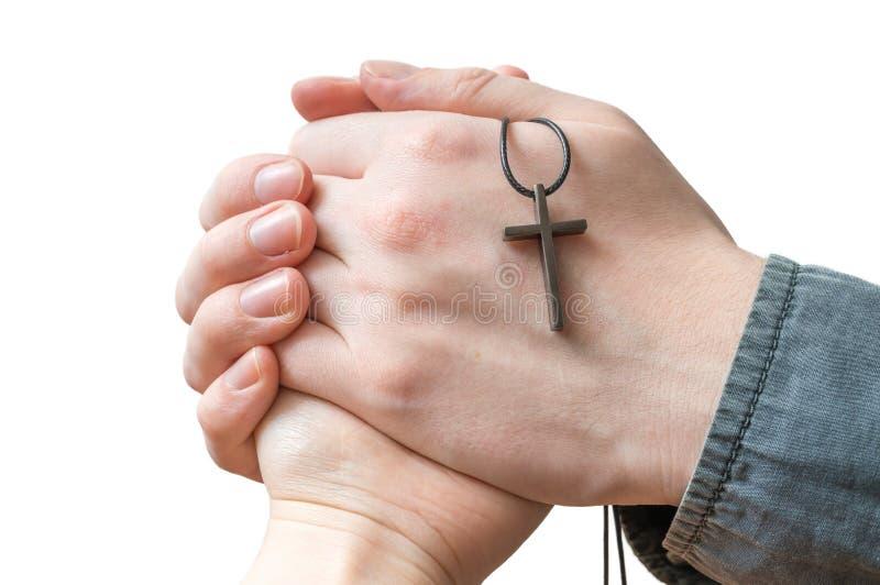 Mãos da mulher da bênção do padre isolada no fundo branco fotos de stock
