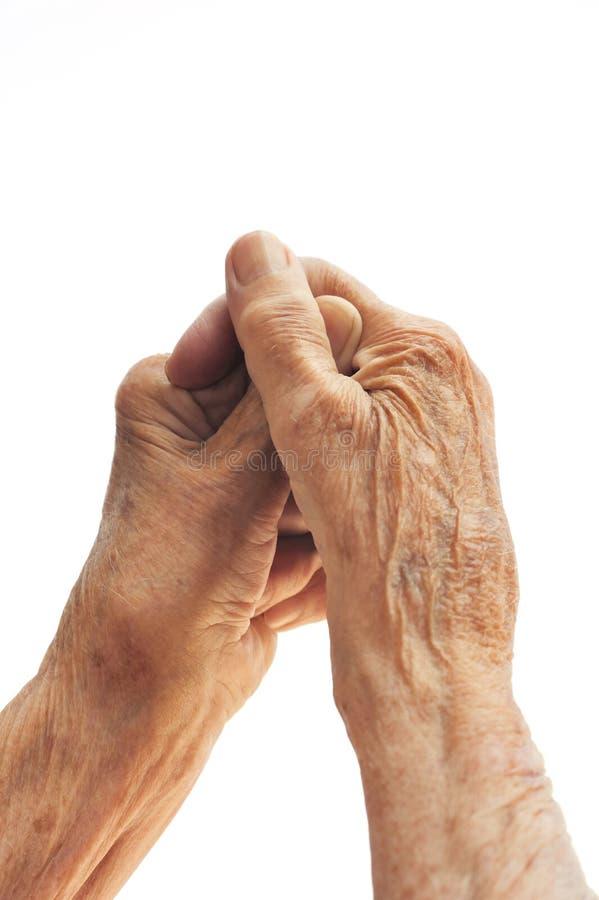 Mãos da mulher sênior isoladas no branco fotos de stock royalty free