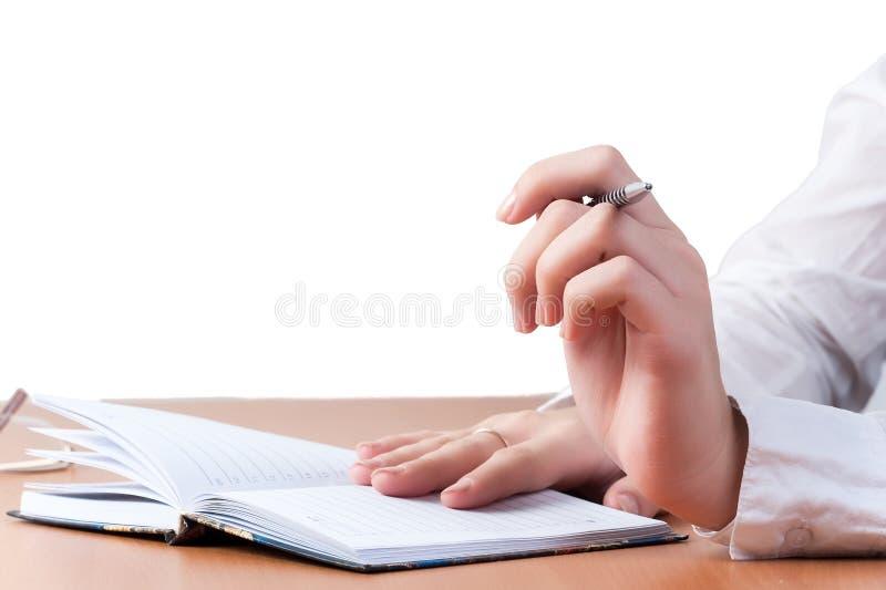 Mãos da senhora refletida do negócio sobre o organizador imagem de stock